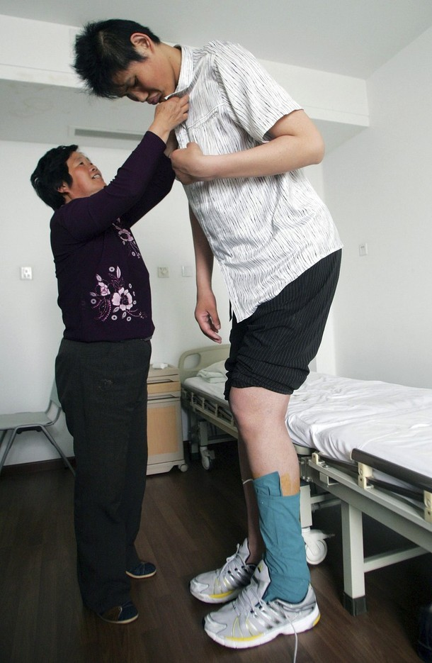 Zhao Liang, who may be the world's tallest person, stands with his mother