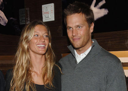 Gisele Bundchen and Tom Brady attend the Ermenegildo Zegna Store